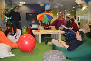 An office with space hoppers, astroturf and bean bags