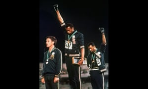 Tommie Smith (centre) and John Carlos raise their gloved fists on the podium at the Mexico Olympics in 1968.