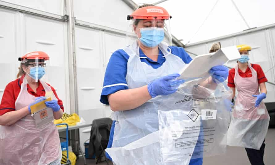 Clinical staff wear personal protective equipment (PPE) as they test key workers for coronavirus at Royal Papworth hospital in Cambridge on 5 May.