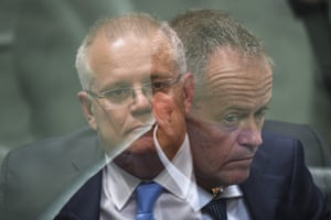 A double exposure image of Australian prime minster Scott Morrison (left) and Australian Opposition leader Bill Shorten during House of Representatives Question Time at Parliament House in Canberra, February 12,  2019.