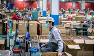 Workers at the Sunwill factory in Foshan, China, as authorities ease restrictions to stimulate production.