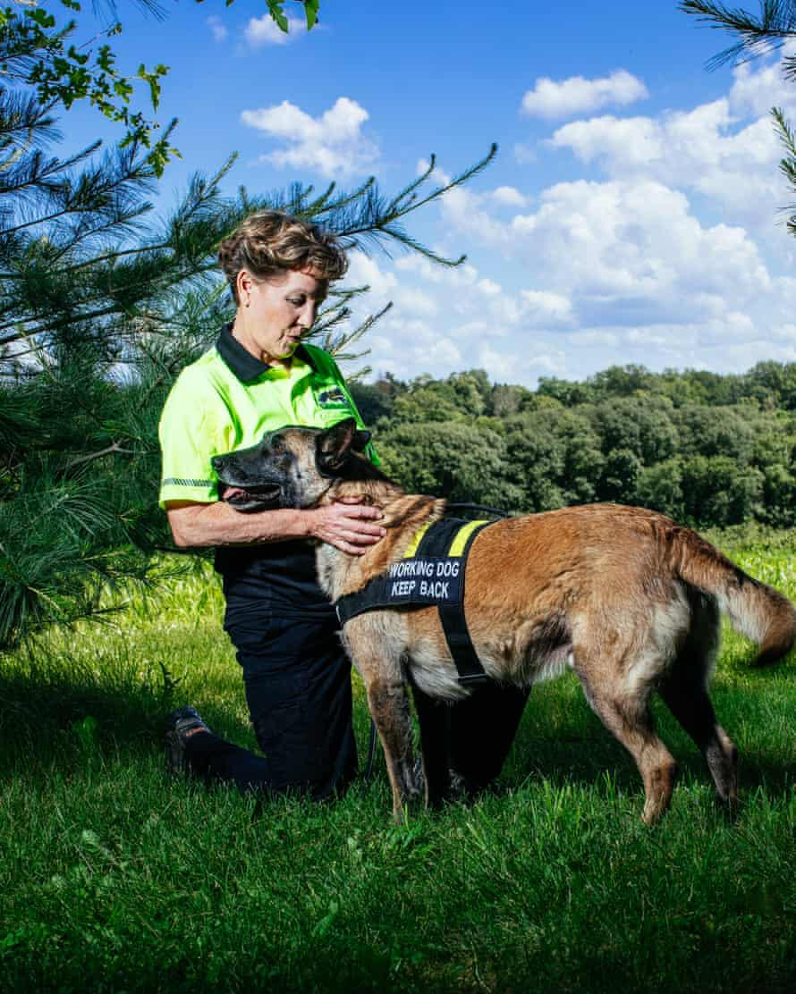 'When they realise I'm a professional, people sigh with relief': Karin TarQwyn with a K9 helper.