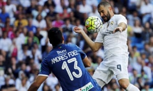 Real Madrid's Karim Benzema heads the ball past Granada's keeper Andrés Fernàndez for the only goal of the game.