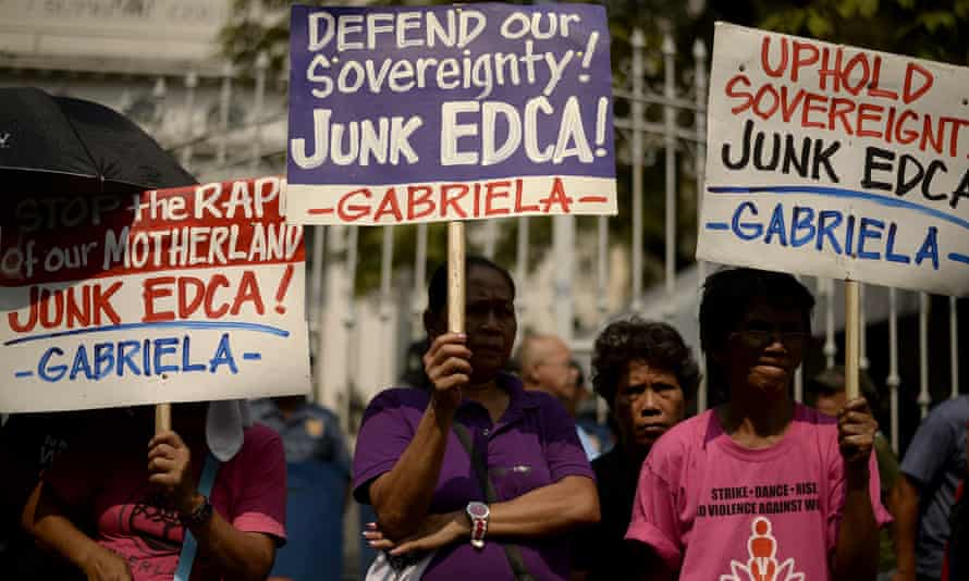 Activists display placards during a protest in Manila against the supreme court ruling that a military accord with the US was constitutional. The US has since been offered use of eight military bases across the nation.