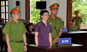 Environmental activist Nguyen Ngoc Anh stands in court during his trial in Vietnam.