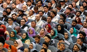 Afghan people attend the opening session of the Afghan Loya Jerga (Grand Council) in April in Kabul, held to discuss the peace process with the Taliban
