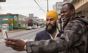 Singh takes a selfie with a passerby