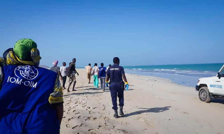 People search a beach for survivors after two boats capsized off the coast in Godoria, Djibouti, leaving an estimated 130 people missing