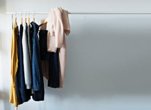 Clothes hanging on clothing rail