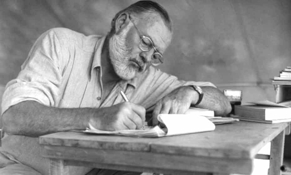 Hemingway working at a portable table while on a big game hunt in Kenya, September 1952. (Photo by Earl Theisen/Getty Images)