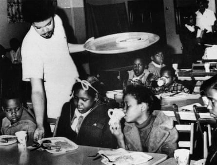 Bill Whitfield of the Black Panther party serves breakfast To local children in Kansas City, April 1969.