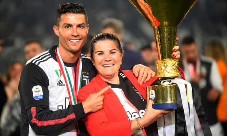 Cristiano Ronaldo and his mother, Dolores Aveiro, pose with the trophy after winning Serie A with Juventus in 2019.