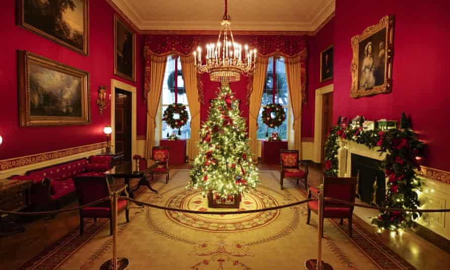 The Red Room of the White House where the tree is decorated with handmade ornaments honouring those fighting the pandemic.