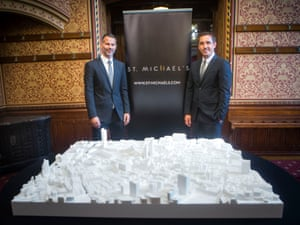 Ryan Giggs and Gary Neville in front of the St Michael's plans.