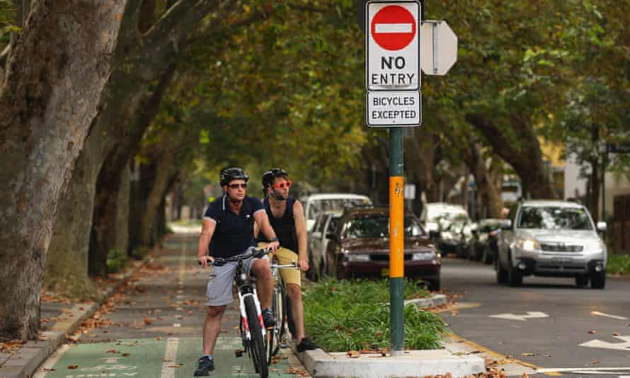 Cyclists in Sydney, wearing helmets. But many are expected to ride without helmets in Australia and New Zealand in a protest on Saturday.