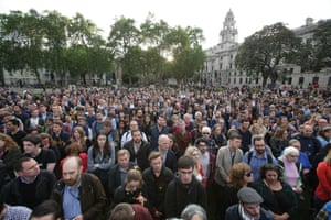 People gather for a vigil in Parliament Square.