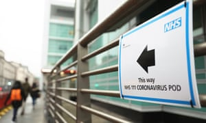 A sign directs directs patients to a coronavirus pod testing area at University College hospital in London.