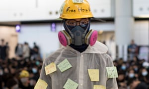 A protester at Hong Kong airport on Friday. Beijing-controlled media portray the campaigners as 'thugs' and 'radicals'.
