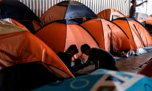 Asylum seekers play at a migrant shelter in Tijuana, Baja California state, Mexico, on 18 October.