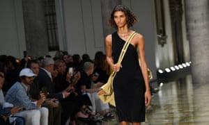model wearing asymetrical black dress