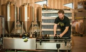 Brewer at work bottling beer at En Stoemelings, Brussels, Belgium.