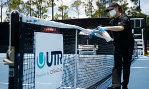 A worker cleans a tennis net in West Palm Beach, Florida. Some US cleaning companies have been busier than ever.