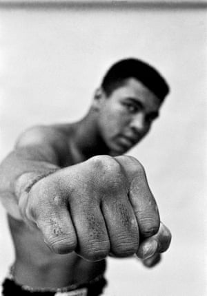 1966 Muhammad Ali, boxing world heavy weight champion showing off his right fist.