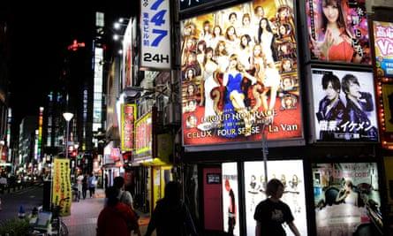 Sign boards of host and hostess club in Kabukicho, Shinjuku, Tokyo, Japan
