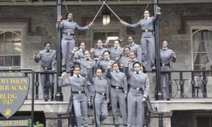 Black female cadets pose with their fists raised at the United States Military Academy at West Point.