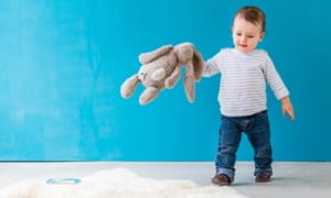 Little boy with toy rabbit
