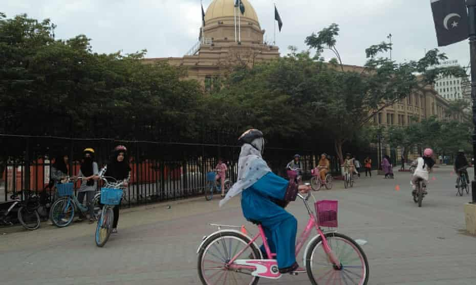 Girls cycle outside Karachi's colonial-era Custom House.