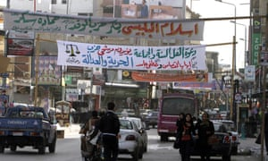 Electoral banners hang across a street in al-Arish Mohammed Abed/AFP/Getty)