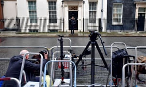 Members of the media outside 11 Downing Street, London, this morning.