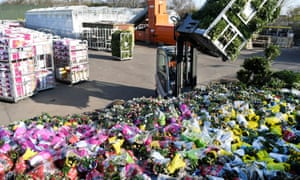 Surplus flowers are destroyed at an auction site in Honselersdijk, the Netherlands