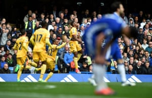 Crystal Palace celebrate after Wilfried Zaha gives them the lead in a shock win at Stamford Bridge.