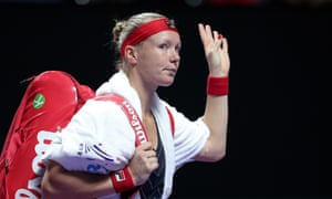 Kiki Bertens leaves the court after retiring from her match against Belinda Bencic in Shenzhen.