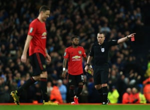 Referee Mr Kevin Friend shows Matic a red card.