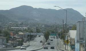 "A view of Ciudad Juárez. The sign on the hill reads: ""Ciudad Juarez, the Bible is the truth. Read it."""