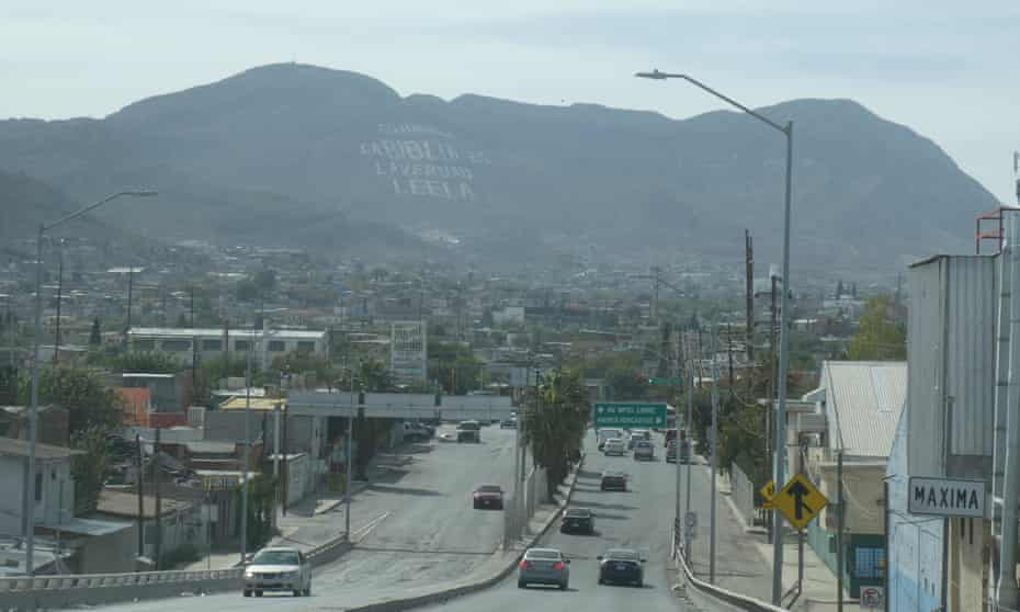 """A view of Ciudad Juárez. The sign on the hill reads: """"Ciudad Juarez, the Bible is the truth. Read it."""""""
