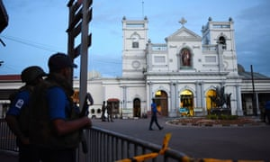 Security personnel stand guard outside St Anthony's Shrine in Colombo on Wednesday, two days after the church was hit in a series of bomb blasts targeting churches and luxury hotels in Sri Lanka.
