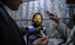 Child undergoes medical exam