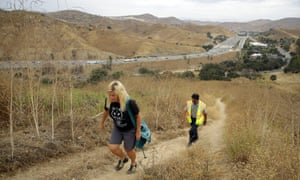 Beth Pratt of the National Wildlife Federation and Caltrans project manager Sheik Moinuddin walk near the planned wildlife crossing.