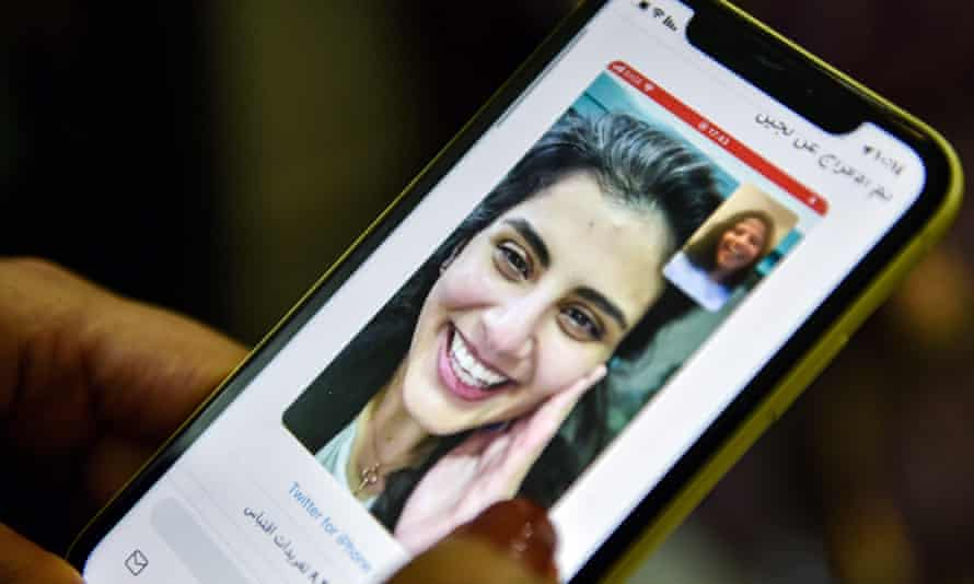 A woman in Riyadh views a tweet posted by Loujain al-Hathloul's sister Lina on Wednesday.