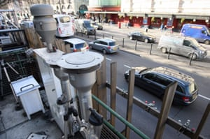 Traffic drives past air quality monitoring equipment on Marylebone Road in London, England