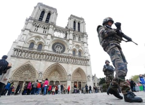 French military patrol near to Notre Dame Cathedral, which will be open to churchgoers.
