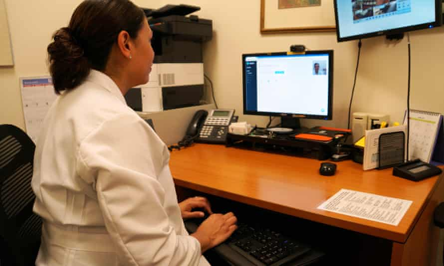 Dr Esther Priegue demonstrates the technology that will allow Choices Women's Medical Center to counsel patients who receive abortion drugs through the mail.