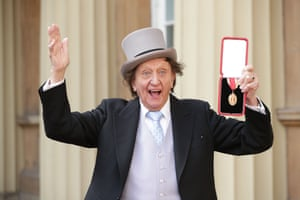 Dodd poses with his medal after he was appointed a Knight Bachelor at an investiture ceremony at Buckingham Palace on 2 March, 2017.