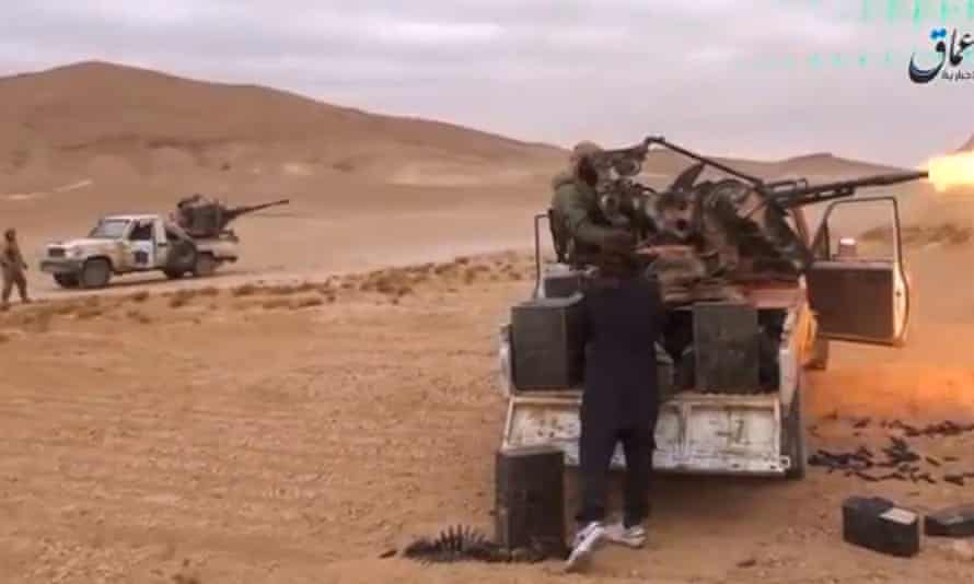 A still image, taken from a video released on 10 December, purported to show Islamic State fighters advancing over the Hayan mountains south of Palmyra.