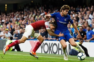 Arsenal's Hector Bellerin uses his head to tackle Chelsea's Marcos Alonso as Chelsea win 3-2 at Stamford Bridge thanks to Alonso's late strike.