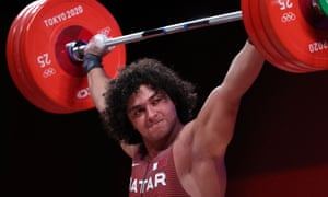 Fares Ibrahim El=Bakh of Qatar competes during the men's 96kg weightlifting  at the Tokyo Olympic Games.